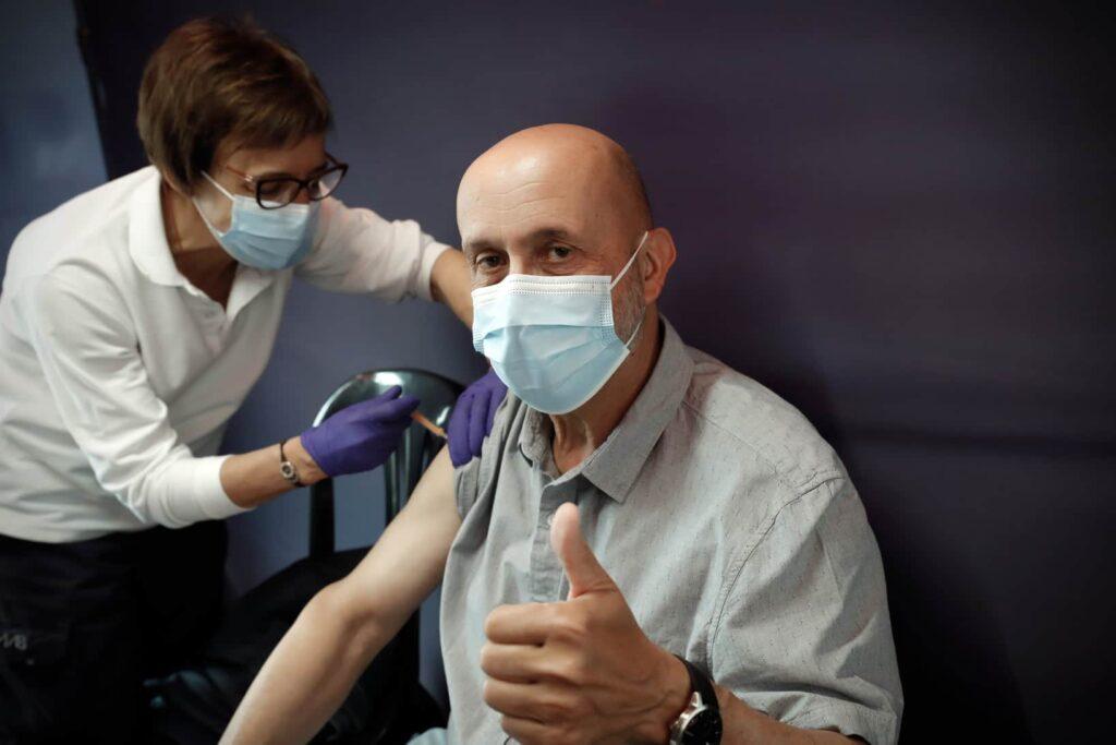 Andorra's Health Minister, Joan Martínez Benazet receiving his AstraZeneca vaccine.